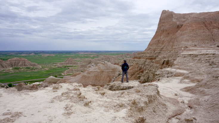 Day Hikes at Badlands National Park: Lucas at the top of saddle pass.