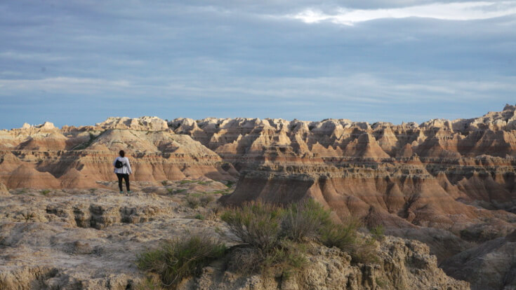 Day Hikes at Badlands National Park: Sarah on the Door Trail.