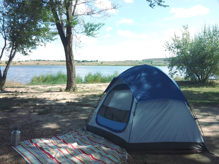 Camping near a scenic lake.